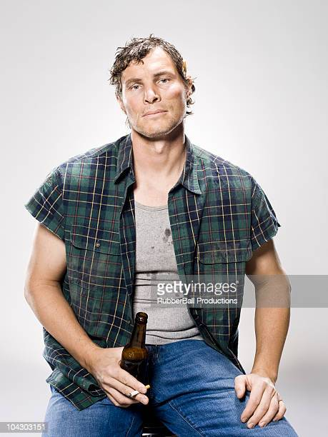 white trash man with a beer and cigarette, - redneck stock photos and pictures