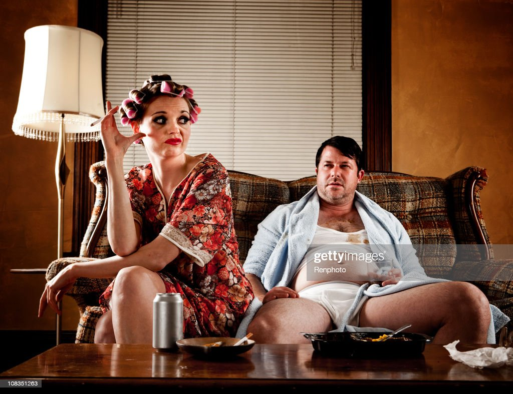 White Trash Series Couple Sitting On Their Couch Stock ...