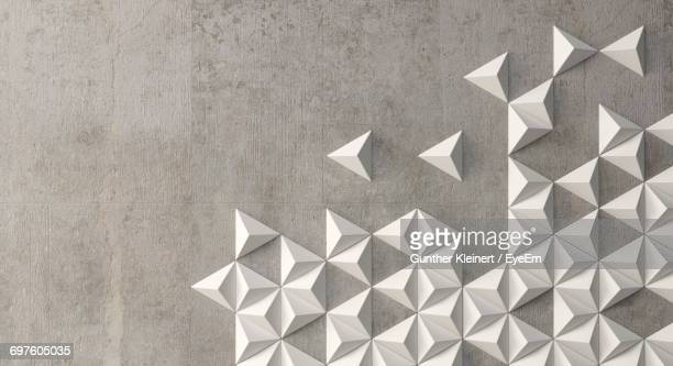 White Triangle Shape Decorations On Concrete Wall