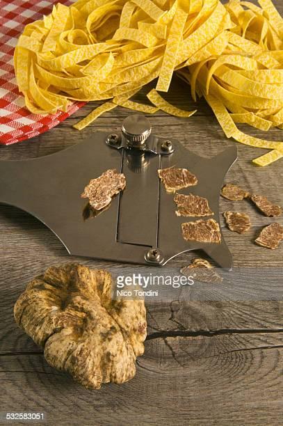 White truffles, truffle slicer and tagliatelle