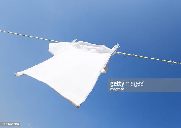 white t-shirt hanging on clothesline - 乾かす ストックフォトと画像