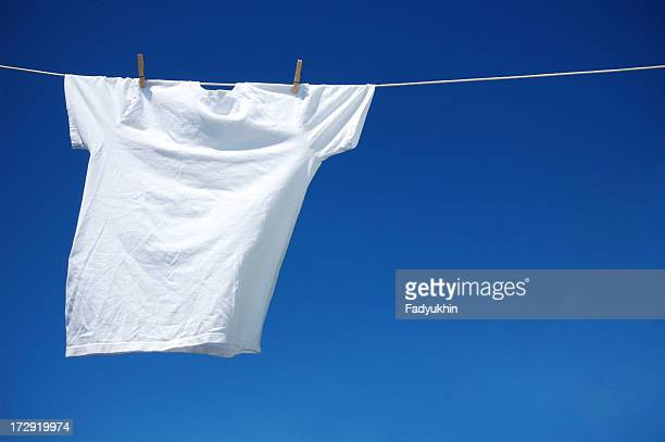 white t-shirt - hanging stock pictures, royalty-free photos & images
