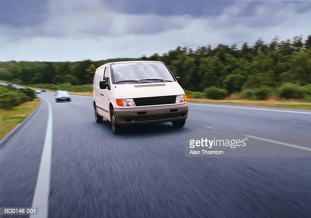 White van driving on road in rain (Digital Enhancement)