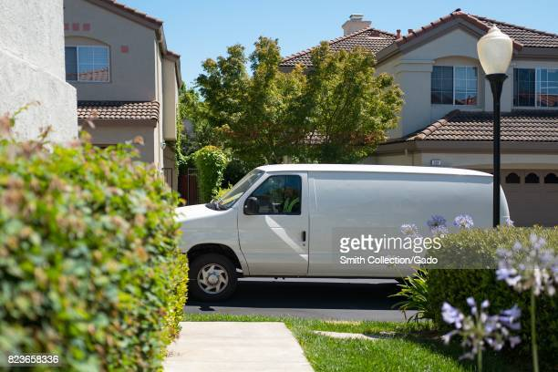 A white van for a third party Amazoncom delivery contractor pulls up in front of a suburban home in the San Francisco Bay Area town of San Ramon...