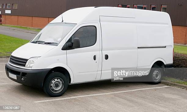 White van for branding parked in parking lot