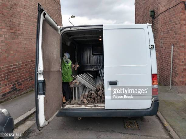 white van with open rear door - on the move stock pictures, royalty-free photos & images