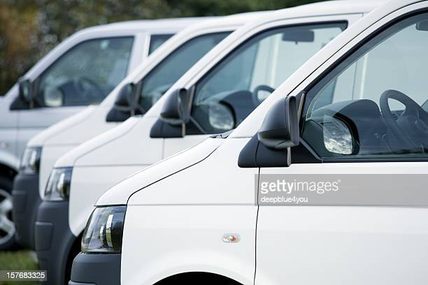 white vans in a row - mini van stock photos and pictures