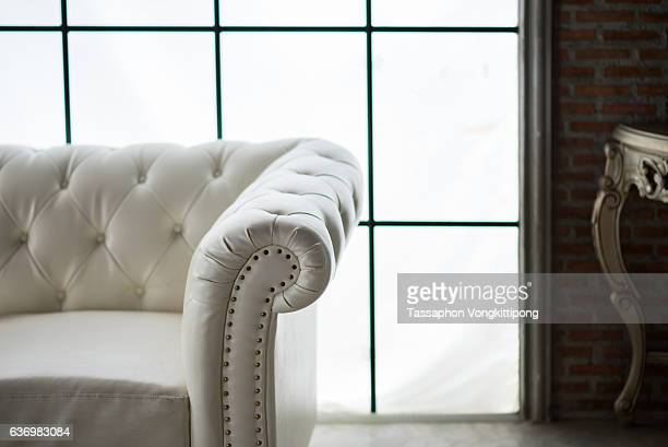 white vintage leather sofa in grunge room