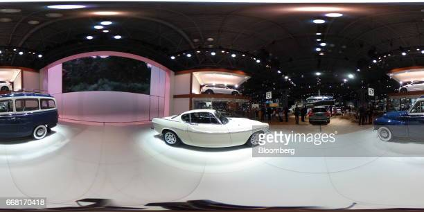 A white Volvo AB P1800 and blue Volvo Duett sit on display during the 2017 New York International Auto Show in New York US on Thursday April 13 2017...