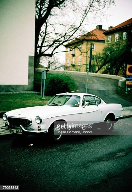 a white volvo p 1800. - volvo stock pictures, royalty-free photos & images