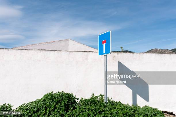 white wall and a blind street traffic sign. - dorte fjalland stock pictures, royalty-free photos & images