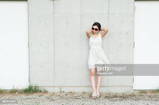 white wall and woman