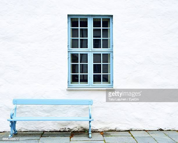White Wall With Window With Blue Frame