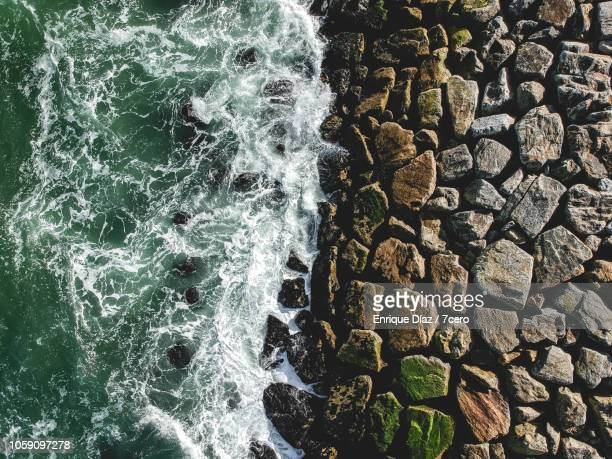 white wash on rocky pier in costa nova, portugal - contrasts stock pictures, royalty-free photos & images