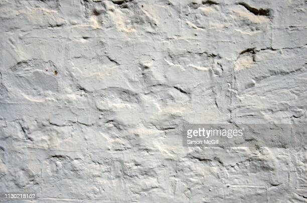 white washed and rendered exterior wall of an old stone cottage - whitewashed stock pictures, royalty-free photos & images