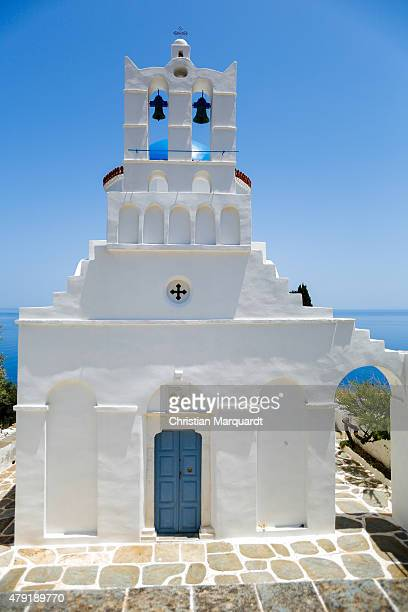 A white washed old Greec orthodox church with bells on top next to the town of Apollonia on the Aegean Sea on June 17 2015 in Sifnos Greece Sifnos is...