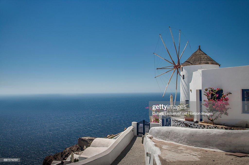 White washed windmill and mediterranean, Santorini, Greece : Stock Photo