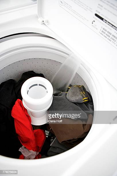 white washing machine filling with water - dana white stock pictures, royalty-free photos & images