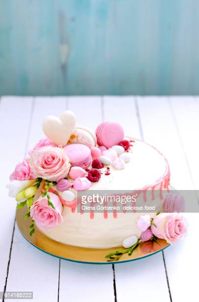 white wedding cake with flowers, macarons