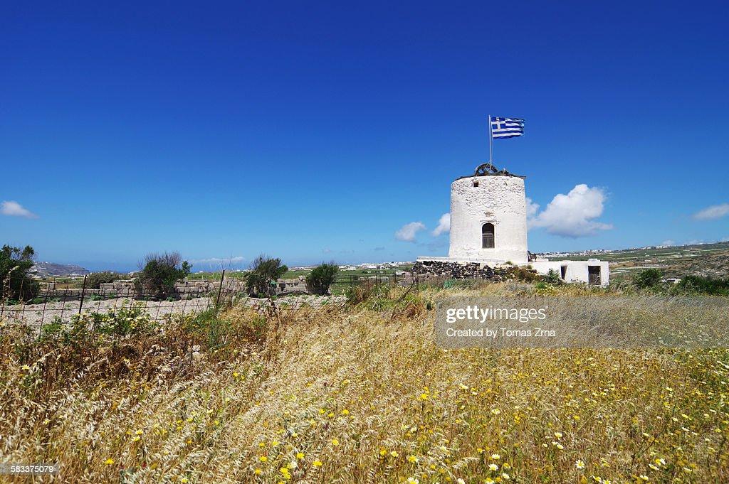 White windmills of Santorini : Stock Photo