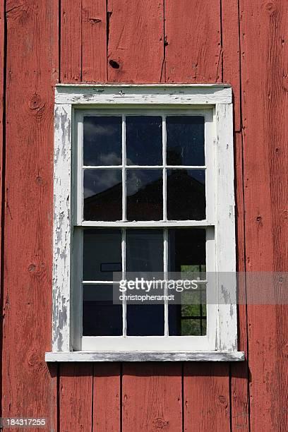 White Window in Red Barn Wall
