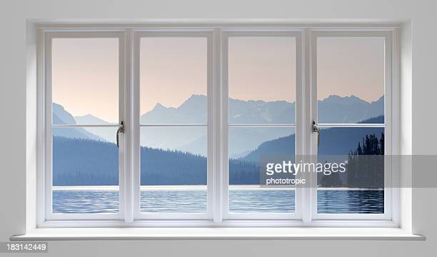 white window with lake view - symmetry stock photos and pictures