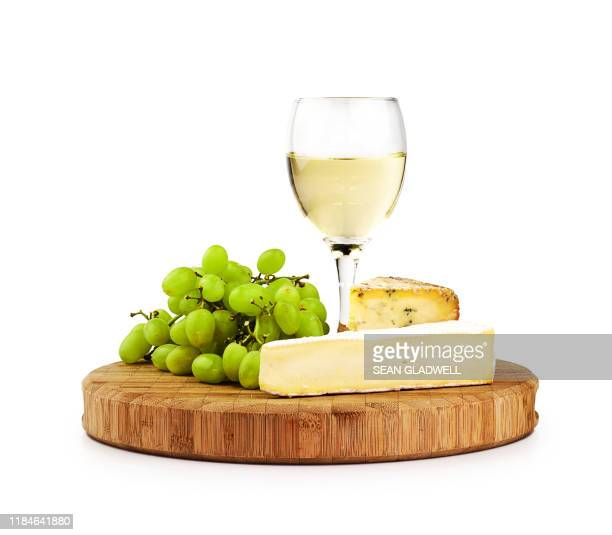 white wine and cheese board - cheese stock pictures, royalty-free photos & images