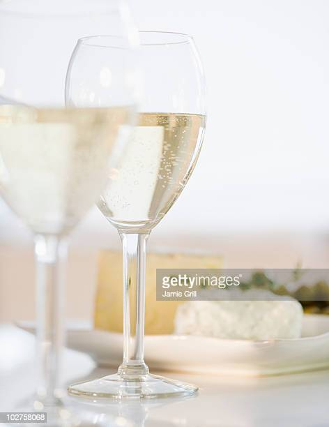 White wine and plate of cheese