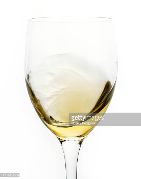 White Wine being swirled in glass