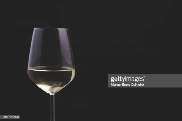 white wine glass - chardonnay grape stock photos and pictures