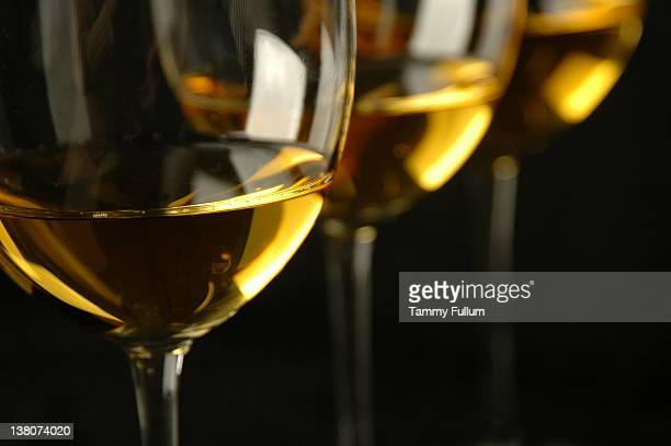 white wine in glasses - chardonnay grape stock photos and pictures