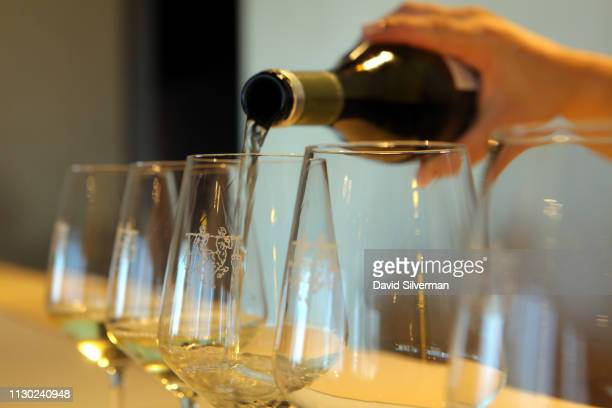 White wine is served to visitors after their tour of the Bodega Ontañón winery and museum on September 30 2018 in Logroño Spain Tourism in Spain is...
