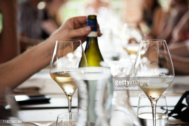white wine on a lunch table - white wine stock pictures, royalty-free photos & images
