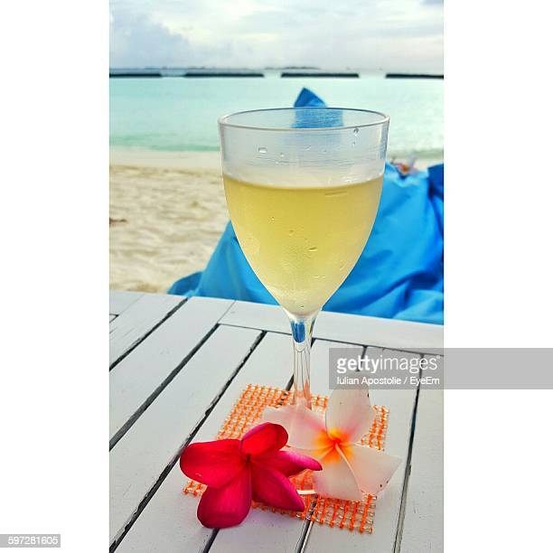 White Wine On Table At Beach