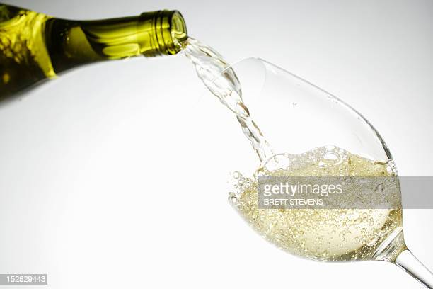 white wine pouring into glass - white wine stock pictures, royalty-free photos & images
