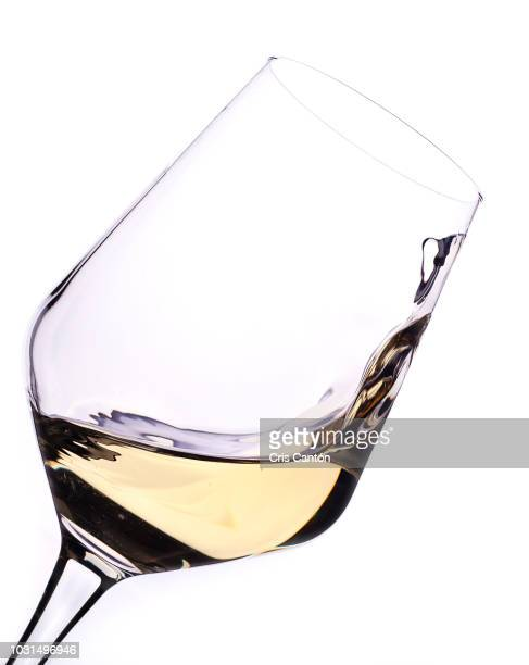 white wine swirling into glass - white wine stock pictures, royalty-free photos & images