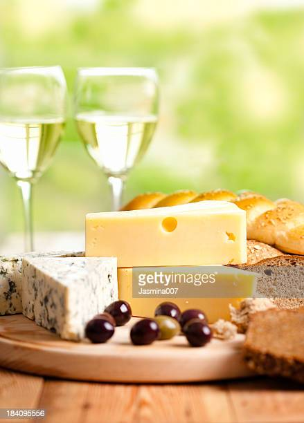 White wine whit cheese and olives