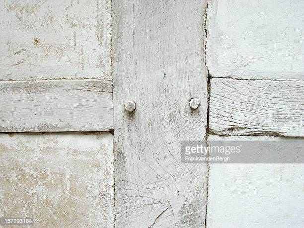 white wooden cross as part of a wall - loam stock photos and pictures