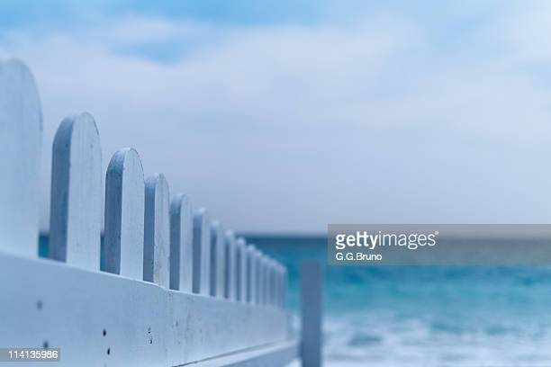 White wooden fence at beach