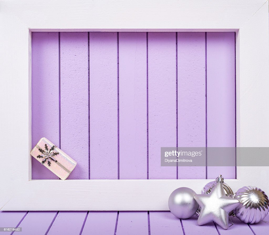 White wooden frame and  christmas decoration over a purple background : Stock Photo