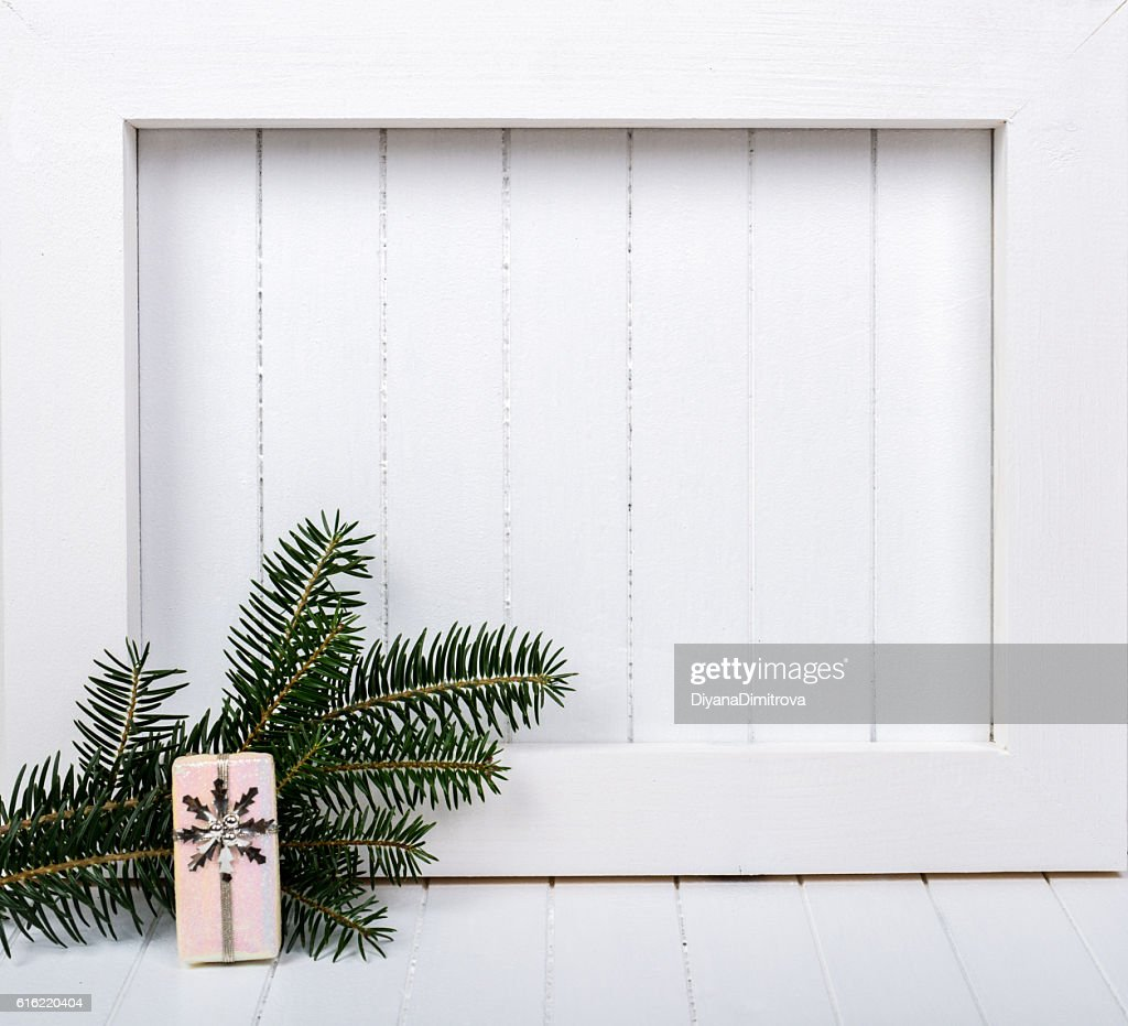 White wooden frame and  christmas decoration over white background : Stock-Foto