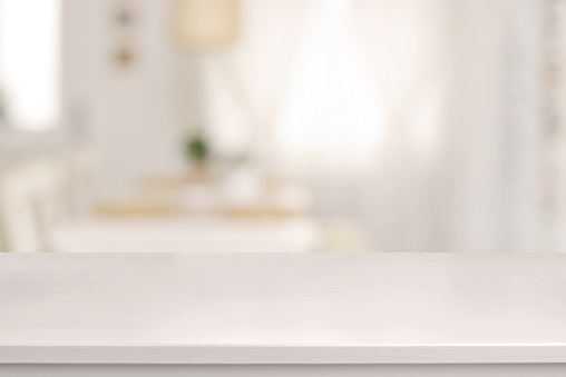 White wooden table and blurred dining room 528443276