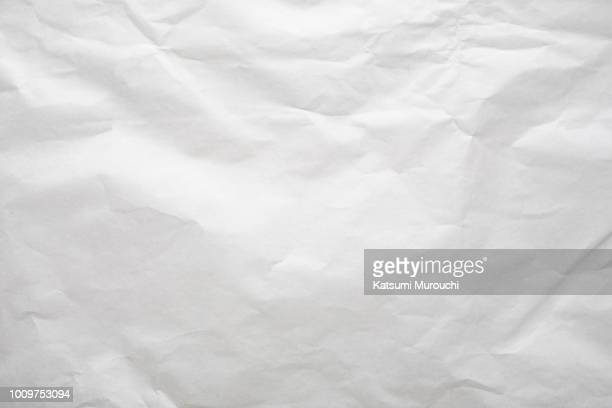 white wrinkled paper texture background - papier stock-fotos und bilder