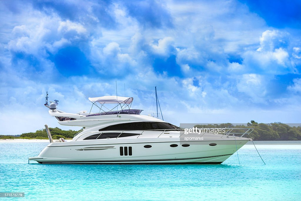 White yacht in the middle of the water : Stock Photo