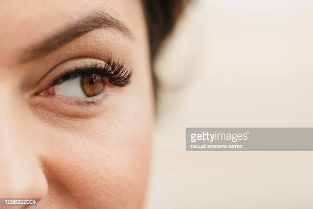 white young woman with eyelash extensions - eyelash stock pictures, royalty-free photos & images