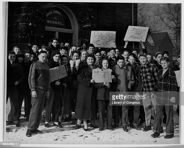 White youths protest African American integration outside Rock Junior High School Little Rock Arkansas in the 1950s