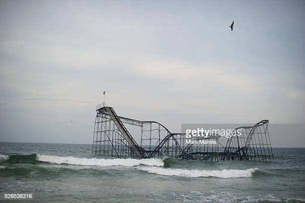Whitecaps roll past the iconic roller coaster submerged in the Atlantic Ocean as a result of Hurricane Sandy in Seaside Heights NJ on May 10 nearly 7...
