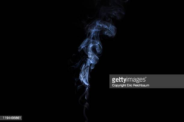 whitee smoke billows up on a black background - fumo materia foto e immagini stock