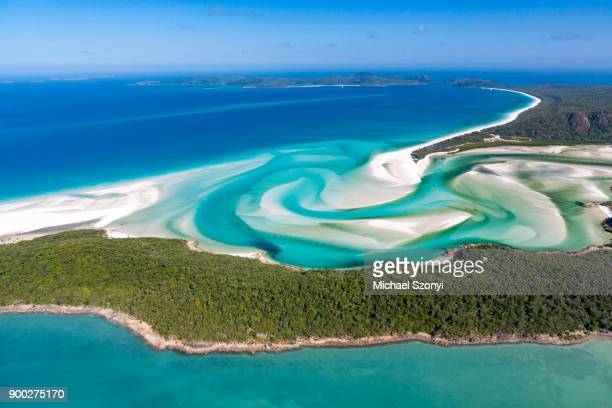 whitehaven beach and hill inlet river meanders, whitsunday islands, queensland - whitehaven beach stock photos and pictures
