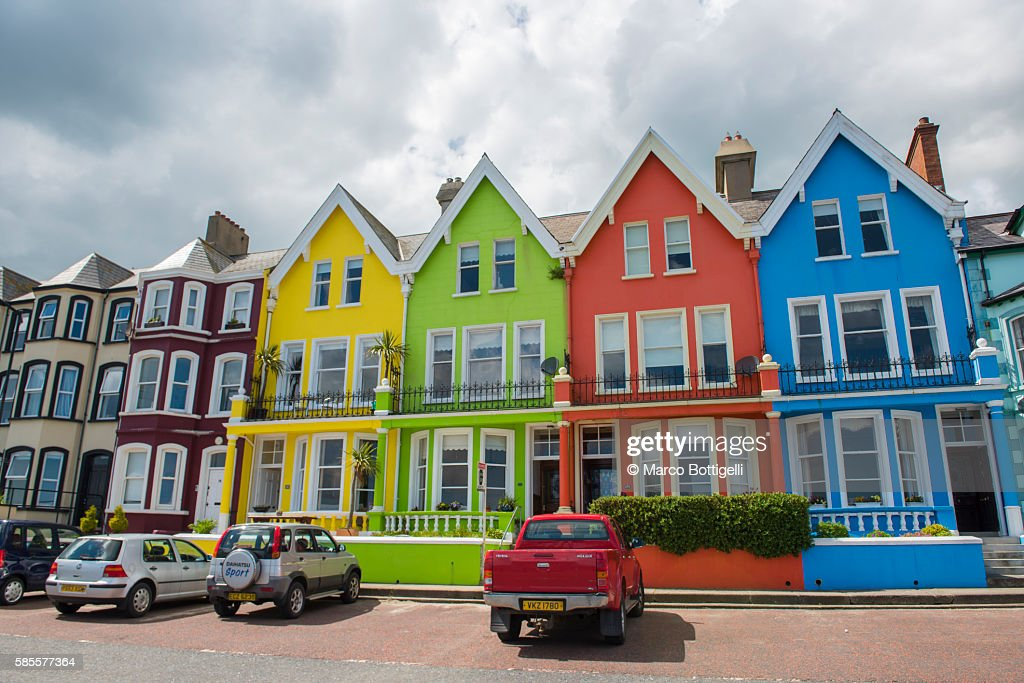 Whitehead, County Antrim, Ulster Region, Northern Ireland, United Kingdom. Colored houses on the waterfront. : Stock Photo